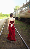 Young woman at train station Stock Photo