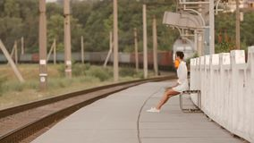 Young woman on train station stock video footage