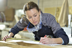 Young woman trainee in carpentry designing Royalty Free Stock Images