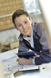 Young woman trainee in carpentry at work Royalty Free Stock Images