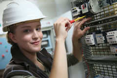 Young woman trainee in electronics training Royalty Free Stock Photography