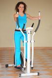 Young woman on training apparatus Royalty Free Stock Photo