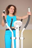 Young woman on training apparatus Royalty Free Stock Image