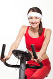 Young woman on a training bicycle Stock Photos
