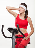 Young woman on a training bicycle Stock Images
