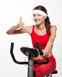 Young woman on a training bicycle Royalty Free Stock Photography