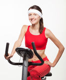 Young woman on a training bicycle Stock Photography
