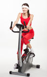 Young woman on a training bicycle Royalty Free Stock Photo