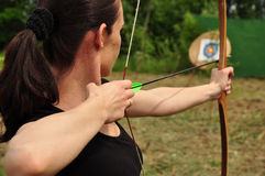 Women with bow. Young woman training with the bow Stock Image