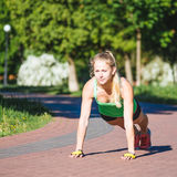 Young woman training in city park at summer day.  Stock Photos