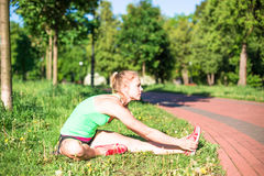 Young woman training in city park at summer day.  Royalty Free Stock Photo