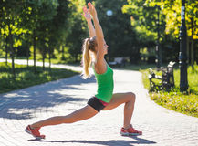 Young woman training in city park at summer day Stock Image