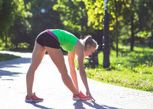 Young woman training in city park at summer day Stock Images