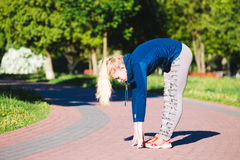 Young woman training in city park at summer day Royalty Free Stock Images