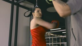 Woman training with coach in boxing club. Young woman training with coach in boxing club stock video