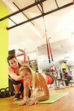 Young woman training with coach in gym Royalty Free Stock Photography