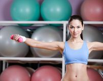 Young woman training with dumbbells Stock Photos
