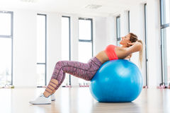 Young woman training with fitball at fitness club. Young woman training with fitball at the fitness club. Fatburning and body shaping concept royalty free stock photography