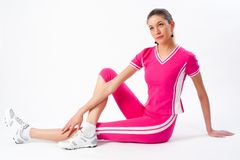 Young woman training in fitness. Young attractive woman doing exercise at white background Stock Photos