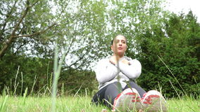 Young Woman Training on Grass in Nature stock footage