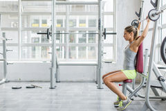 Young woman training in gym Royalty Free Stock Images