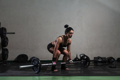 Young woman training in the gym Stock Images