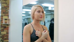 Young woman training in a gym stock video footage