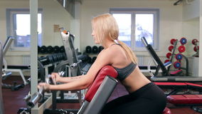 Young woman training in a gym stock footage
