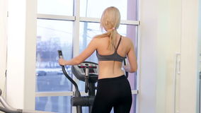 Young woman training in a gym stock video