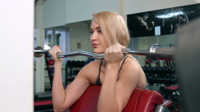 Young woman training in a gym closeup stock footage