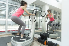 Young woman training in the gym Royalty Free Stock Photo