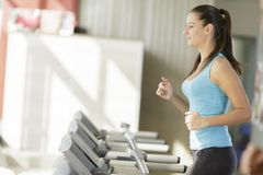Young woman training in the gym Royalty Free Stock Image