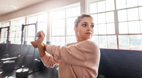 Young woman training in gymnasium. Royalty Free Stock Images