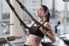 Young woman training hard in a gym Stock Photo