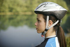 Young woman training on mountain bike and cycling in park Stock Images