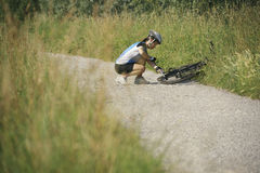 Young woman training on mountain bike and cycling in park Royalty Free Stock Image