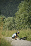 Young woman training on mountain bike and cycling in park Stock Image