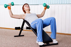 Young woman training for muscle of chest Stock Photo