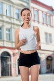 Young woman training outdoors in the morning Royalty Free Stock Images