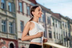 Young woman training outdoors in the morning Royalty Free Stock Photography