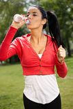 Young woman training in park drinking water stock photos