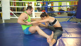 Young woman training pre-match warm-up in the boxing ring with her trainer. stock video