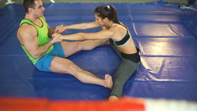Young woman training pre-match warm-up in the boxing ring with her trainer. stock video footage