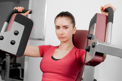Young woman training. A pretty young woman training in a fitness center Royalty Free Stock Images