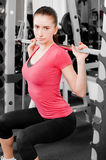 Young woman training. A pretty young woman training in a fitness center Stock Image