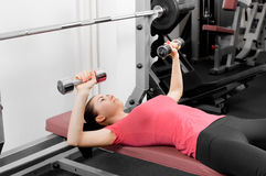 Young woman training. A pretty young woman training in a fitness center Stock Photography