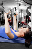 Young woman training. A pretty young woman training in a fitness center Stock Photos