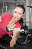 Young woman training. A pretty young woman training in a fitness center Royalty Free Stock Photography