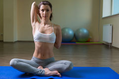 Young woman training in yoga asana Royalty Free Stock Image