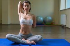 Young woman training in yoga asana Royalty Free Stock Image